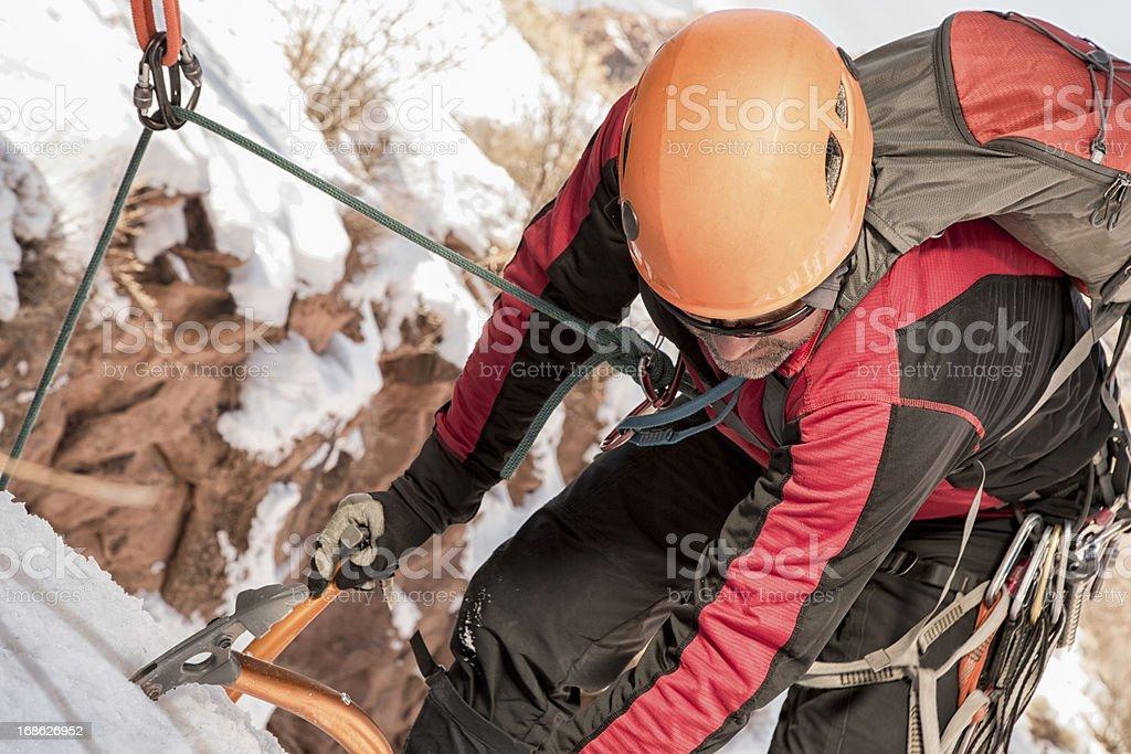 Young Man Ice Climbing stock photo