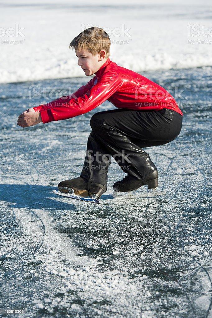 Young man ice skating on Bled lake stock photo