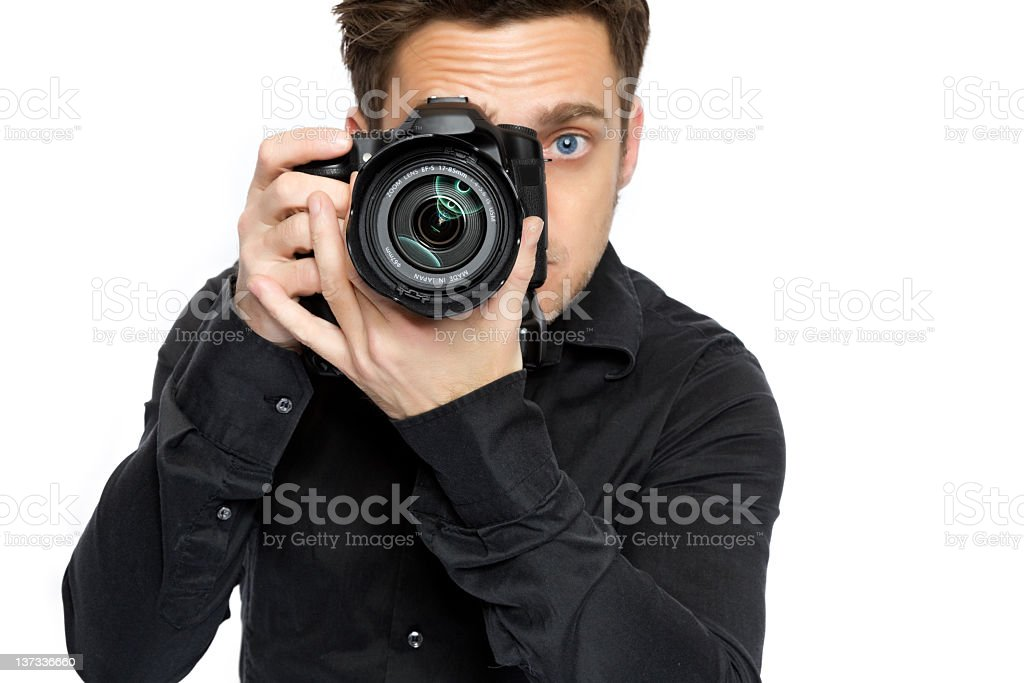 A young man in a black shirt using a camera royalty-free stock photo