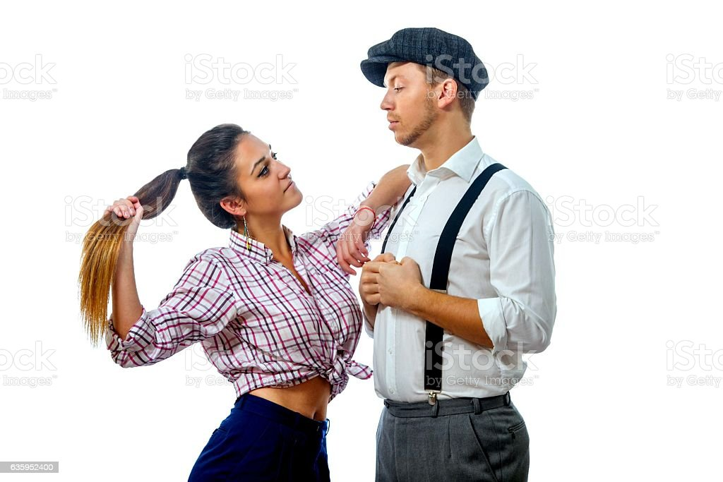young man in a cap and woman in shorts stock photo