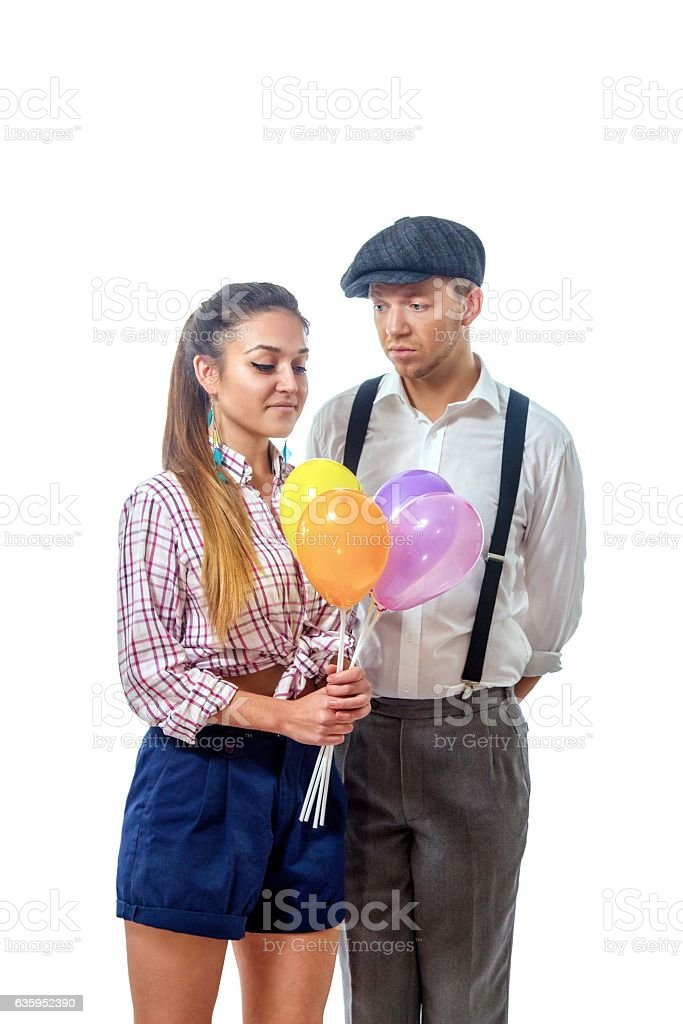 young man in a cap gave the girl balloons stock photo