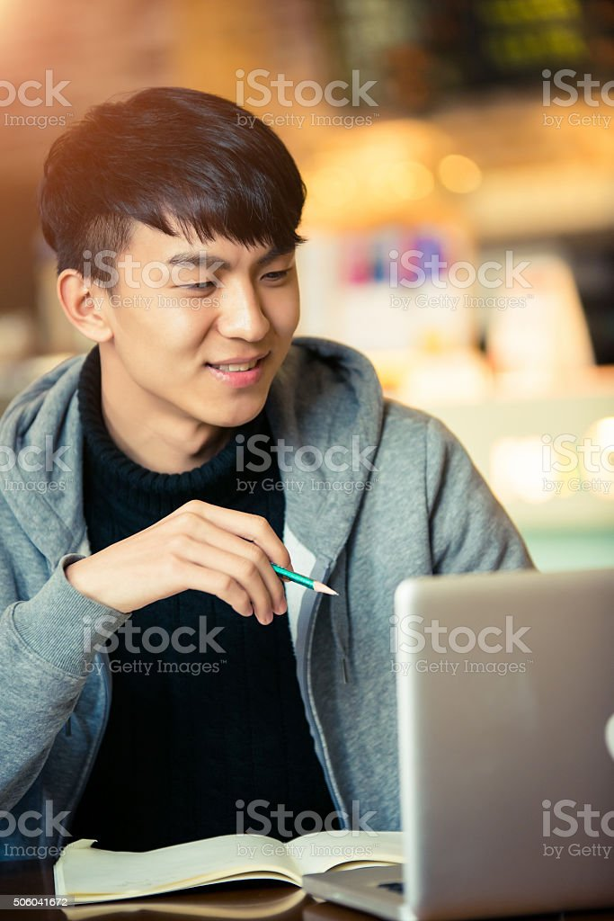 young man in a coffee house stock photo