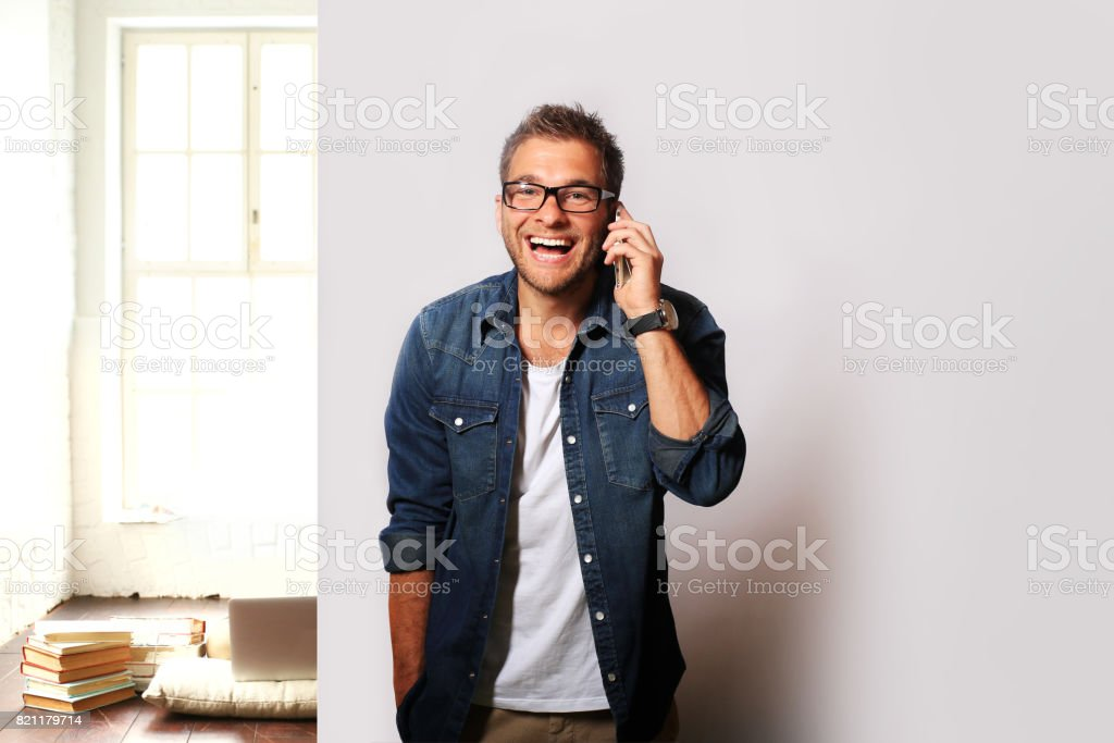 Young man in a denim stock photo