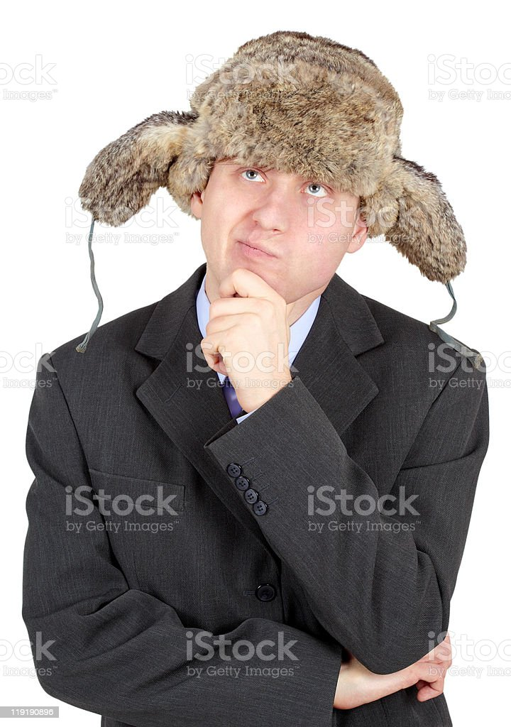 Young man in a fur hat dreams on white background royalty-free stock photo