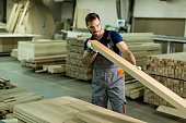 Young man in a furniture factory