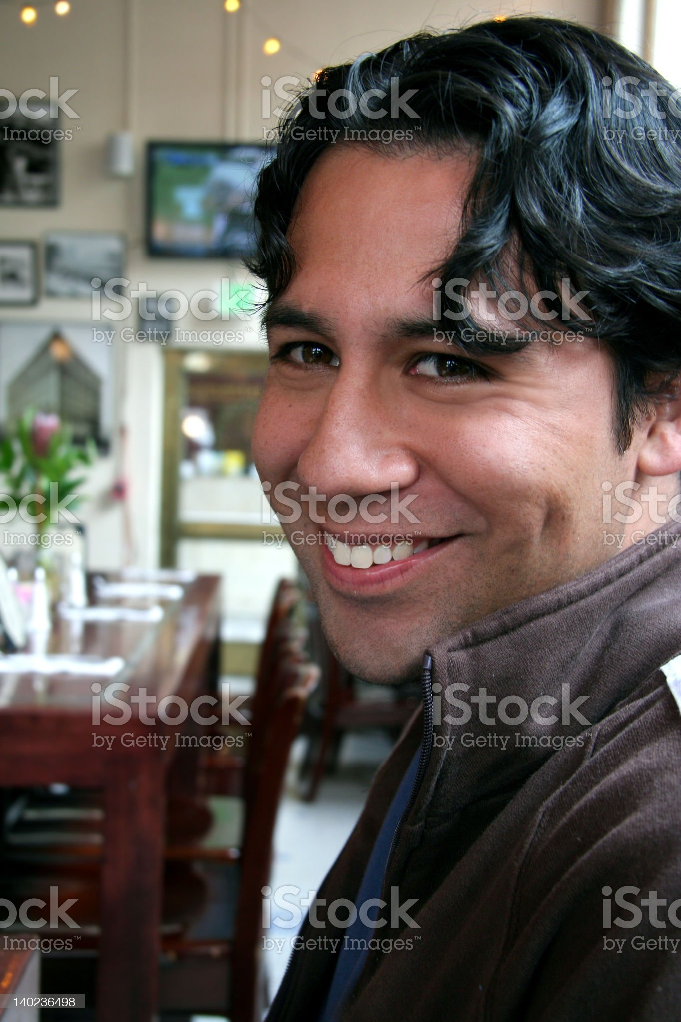 Young man in a restaurant royalty-free stock photo
