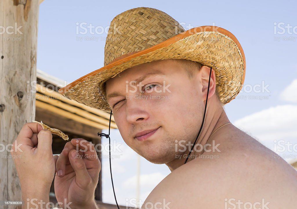 young man in a straw hat royalty-free stock photo