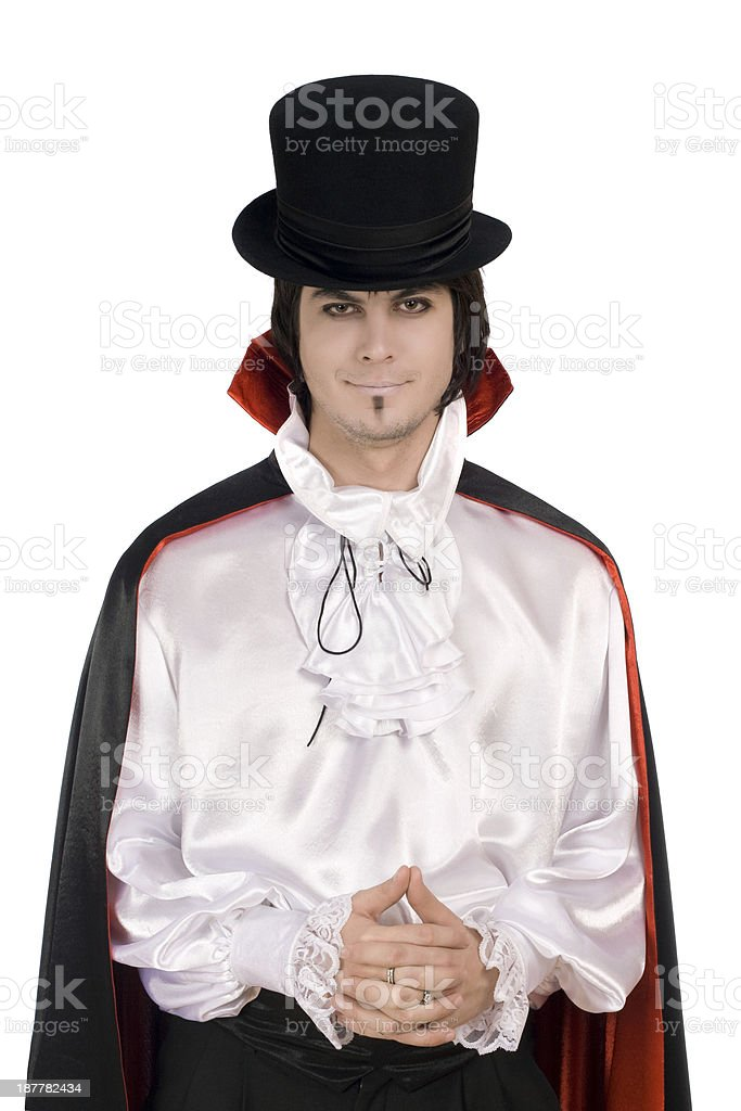 young man in a suit of Count Dracula stock photo