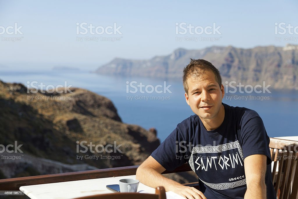 Young man in a summer resort, Santorini royalty-free stock photo