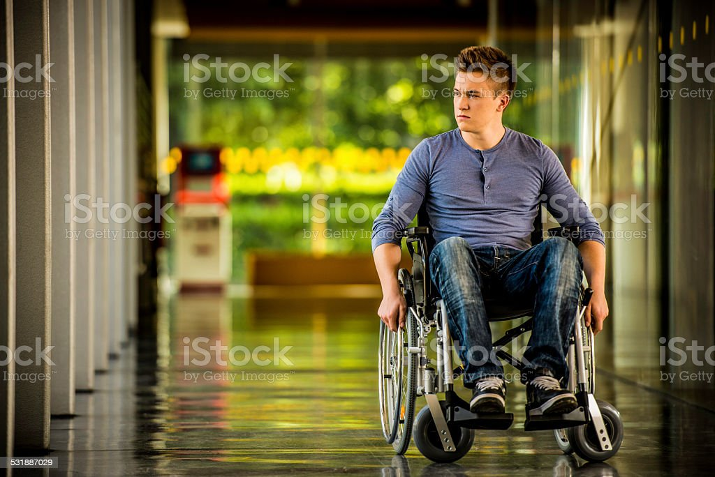 Young Man in a Wheelchair stock photo