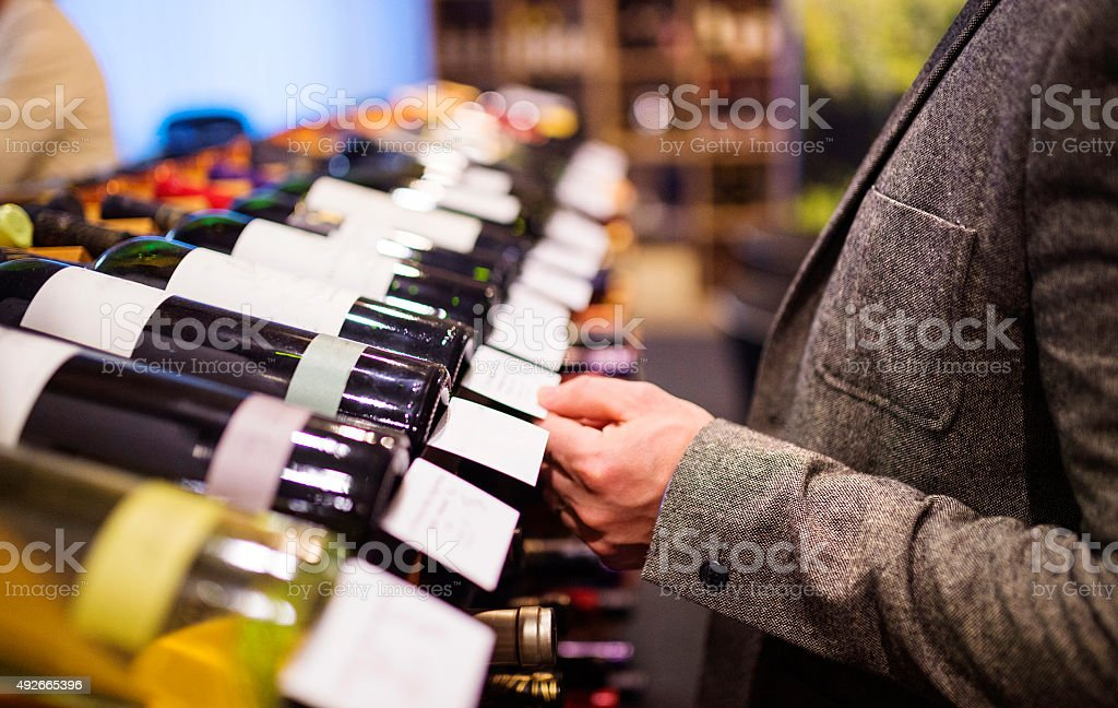 Young man in a wine shop stock photo