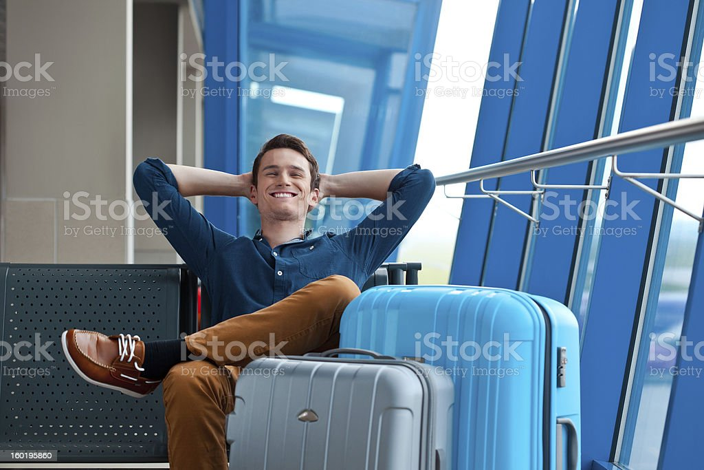 Young man in an airport lounge stock photo