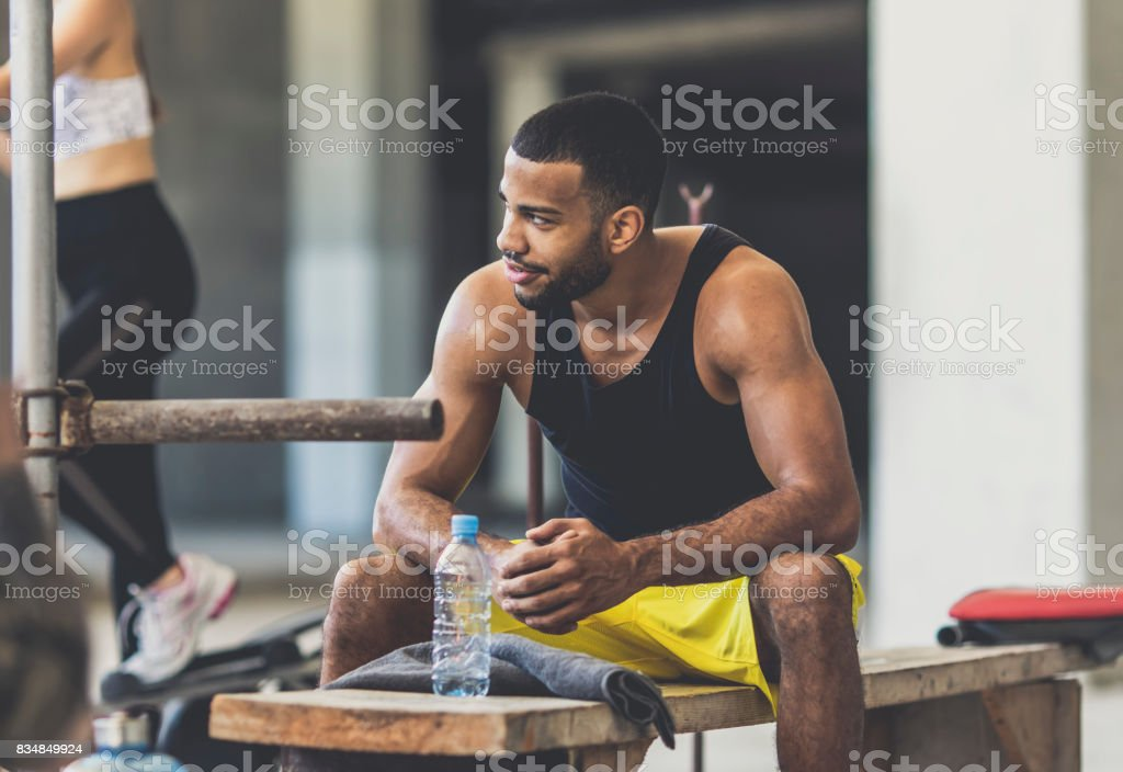 Young man in an urban gym stock photo