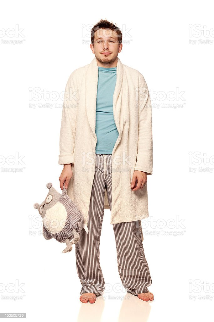 Young man in bathrobe with stuffed animal. stock photo