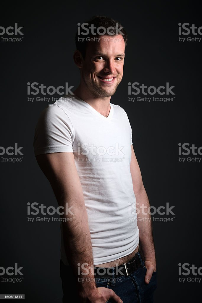 Young man in blue jeans and white shirt royalty-free stock photo
