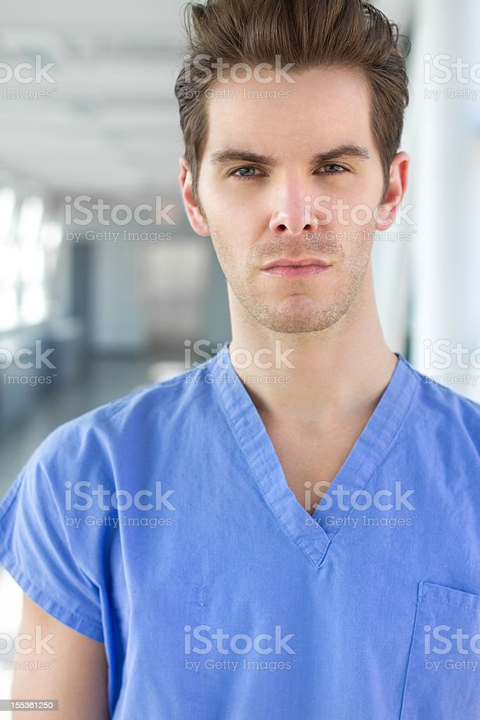 Young Man in Blue Scrubs stock photo