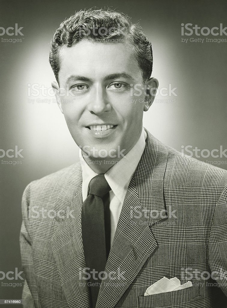 Young man in checked jacket posing in studio, (B&W), (Close-up), (Portrait) stock photo