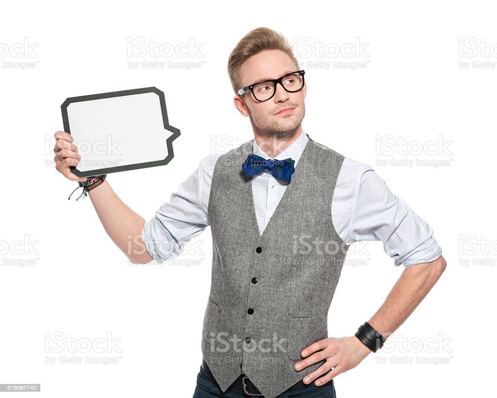 Young man in classical outfit holding speech bubble stock photo