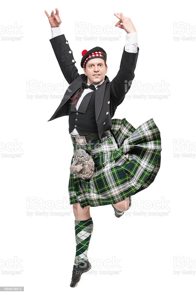 Young man in clothing for Scottish dance stock photo