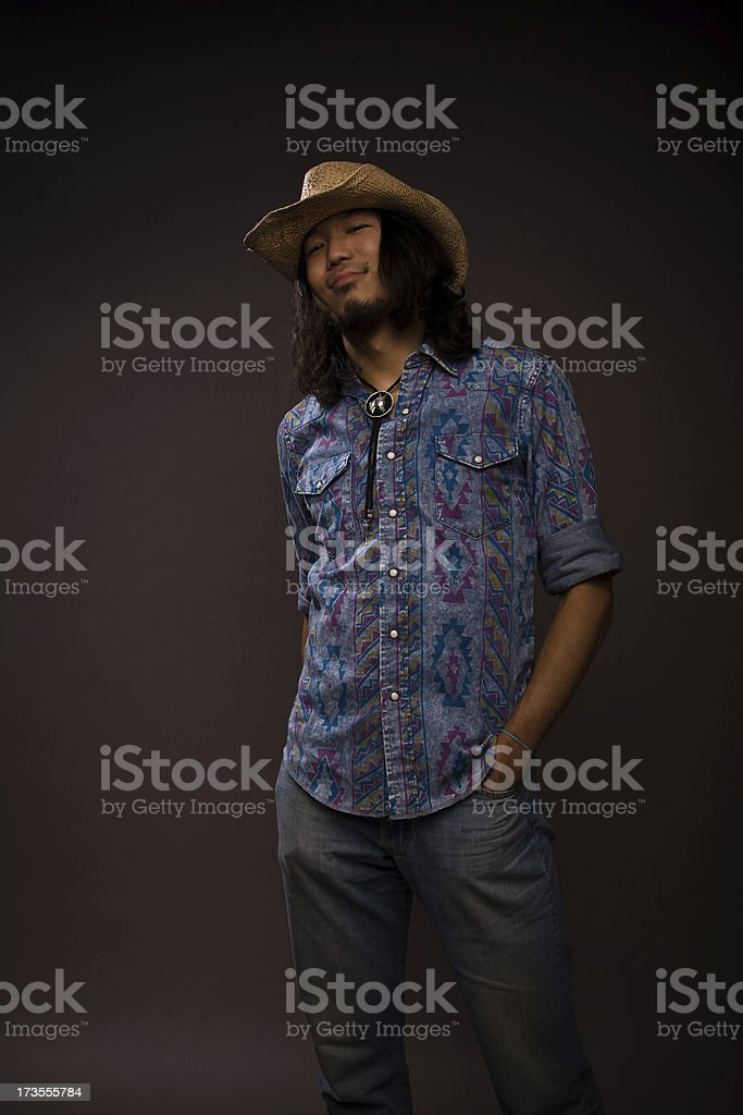 Young man in cowboy outfit royalty-free stock photo
