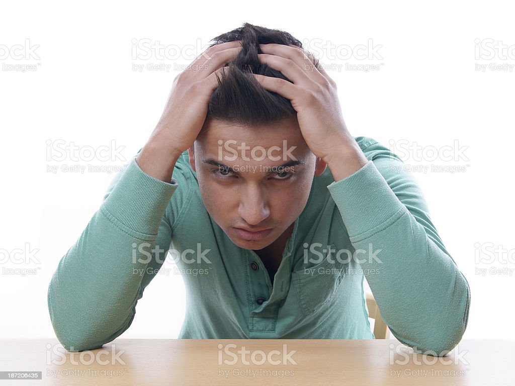 young man in despair stock photo