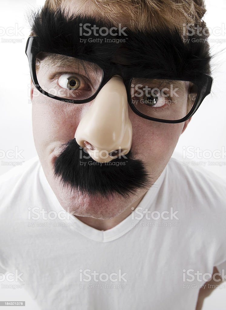 Young Man in Disguise stock photo