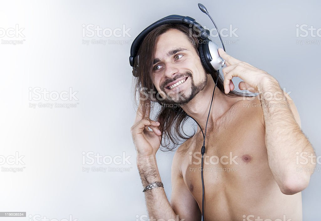 young man in ear-phones listening the music stock photo