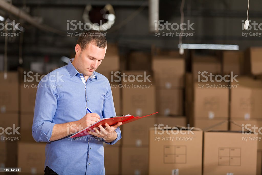 Young Man in Factory stock photo