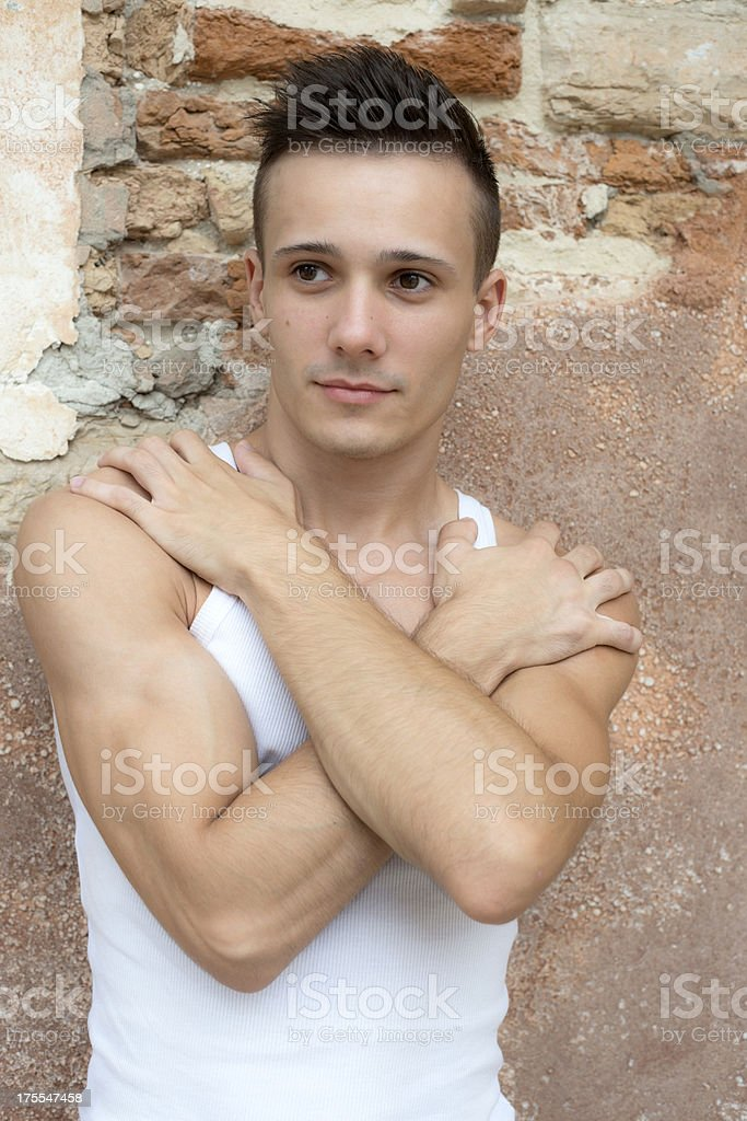 Young Man in front of Old Brick Wall Venice royalty-free stock photo