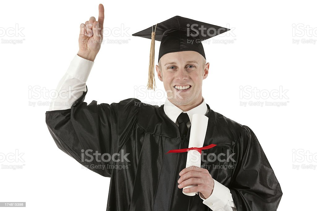 Young man in graduation gown, holding degree and pointing up royalty-free stock photo