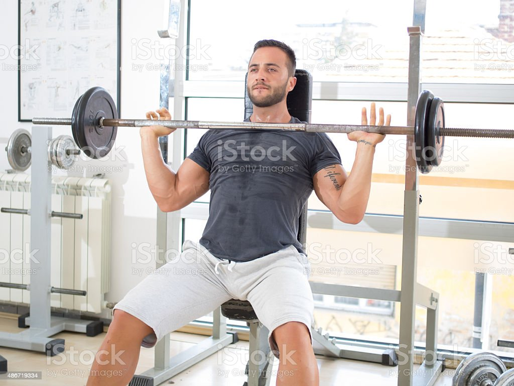 Young man in Gym stock photo