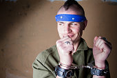 Young Man in Handcuffs with Big Smirk on His Face