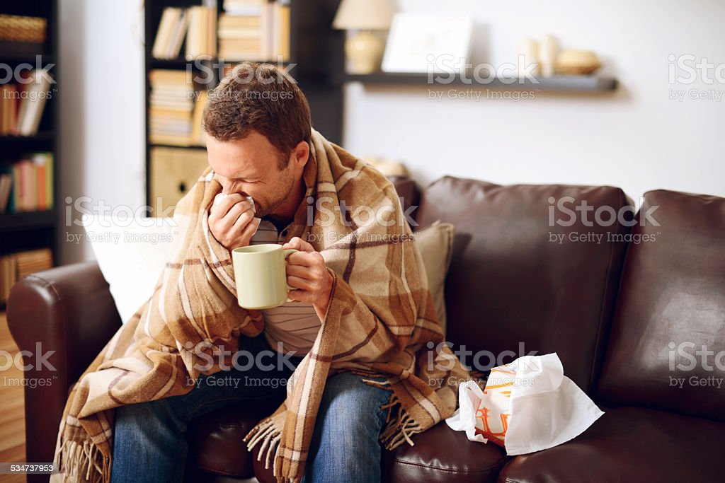 young man in home interior stock photo