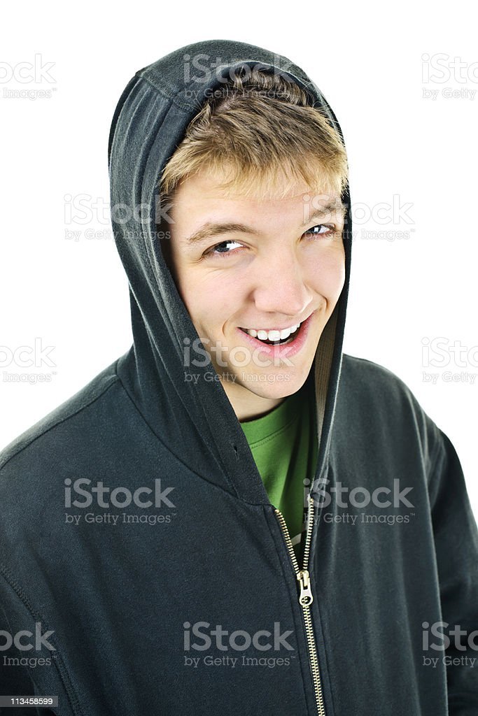 Young man in hoodie smiling stock photo