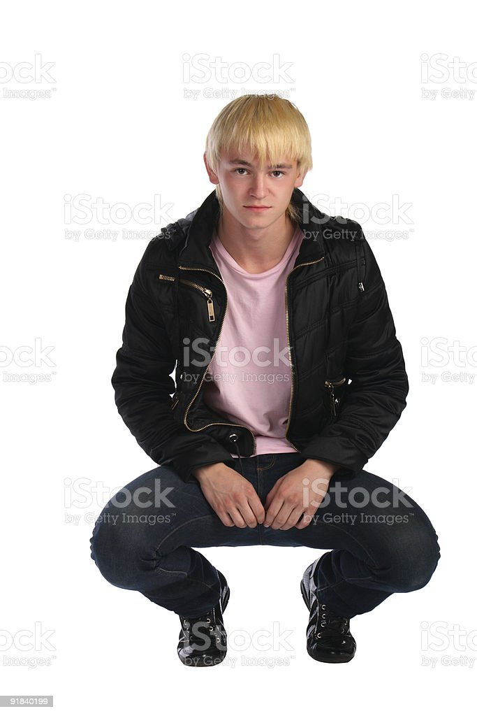 Young man in jacket sits royalty-free stock photo