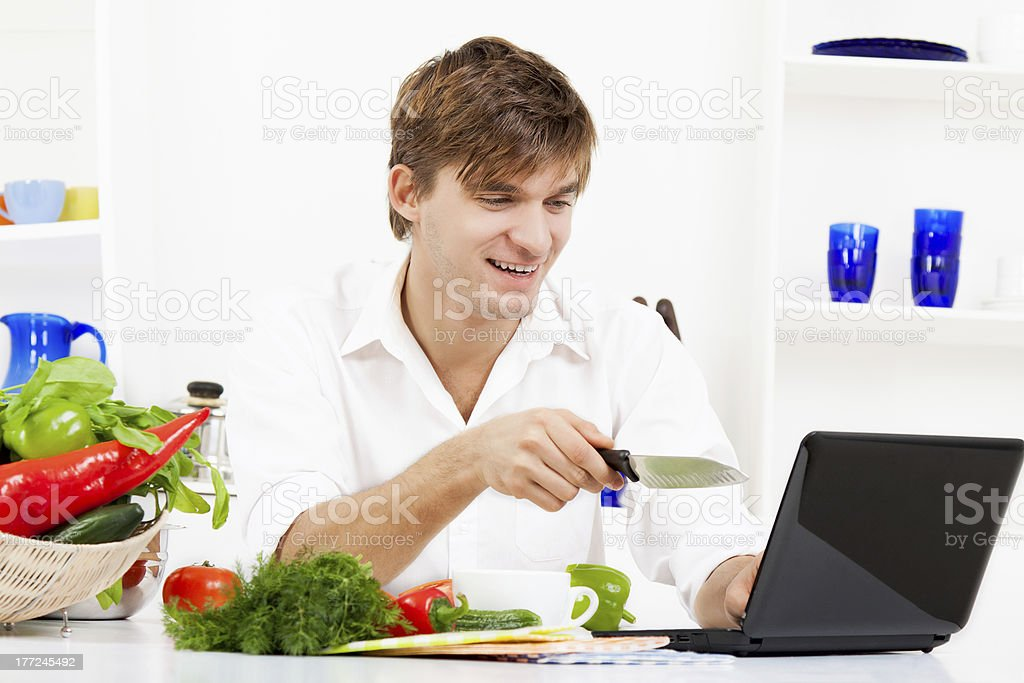 young man in kitchen royalty-free stock photo