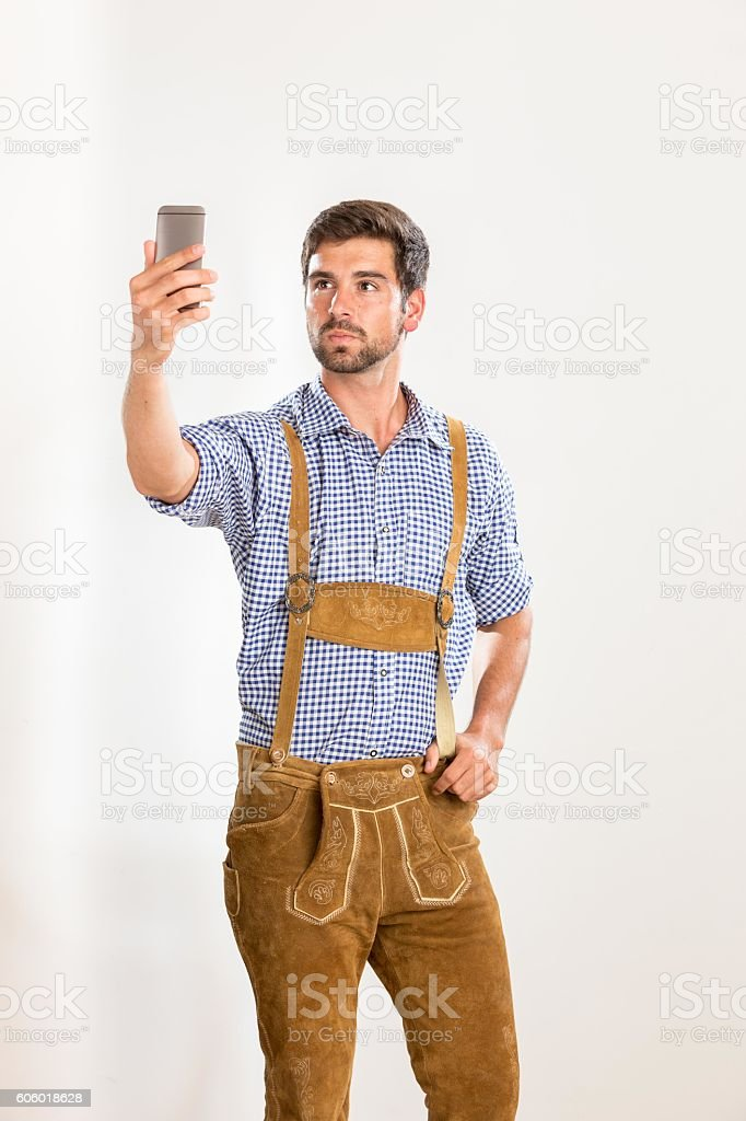 Young man in leather pants takes a selfie stock photo