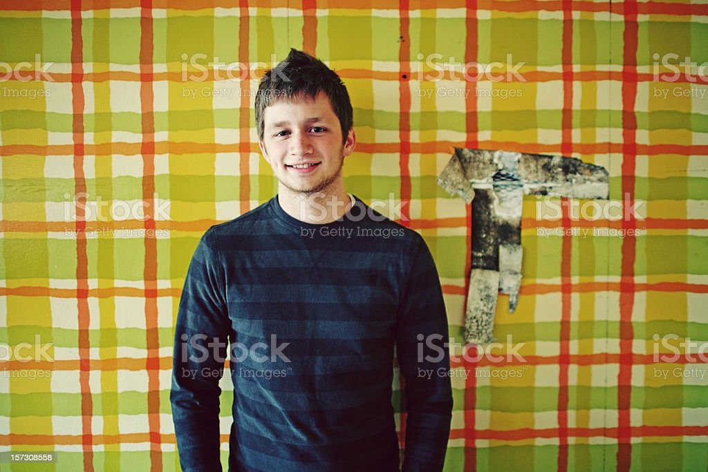Young Man in Long Sleeves on Retro Wallpaper royalty-free stock photo