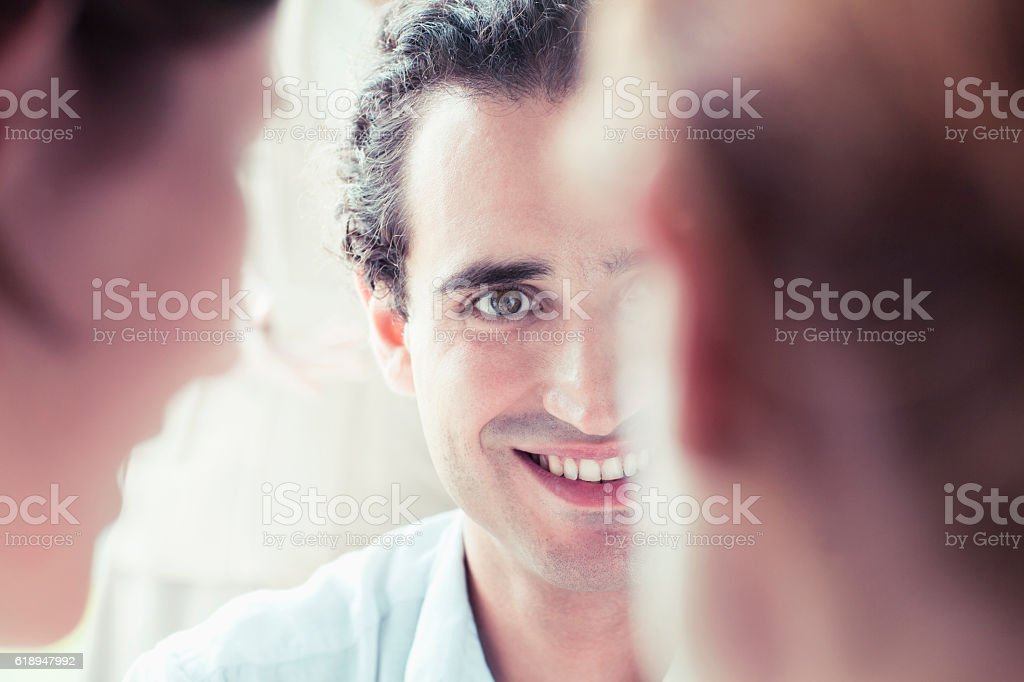 Young man in meeting smiling stock photo