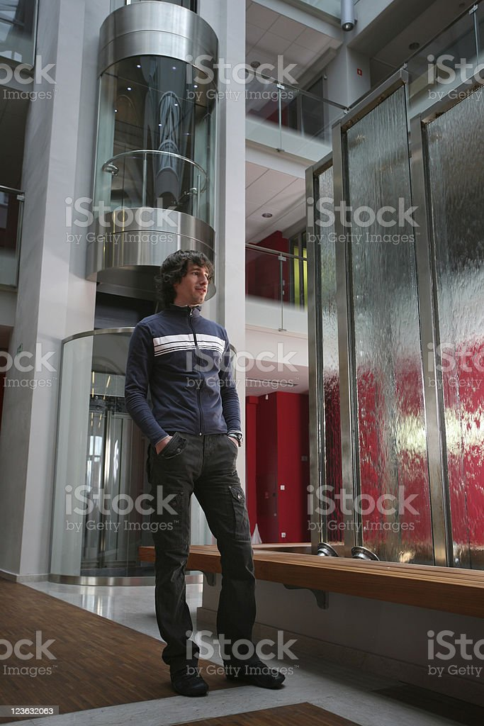 Young man in modern interior royalty-free stock photo