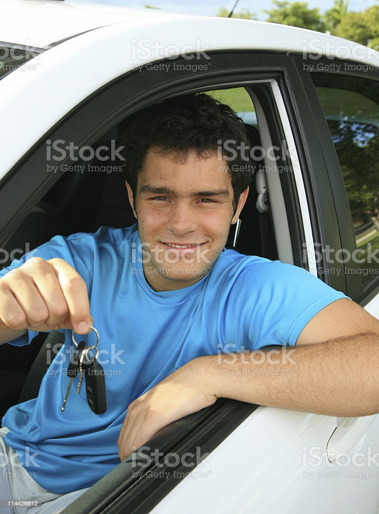 young man in new car royalty-free stock photo