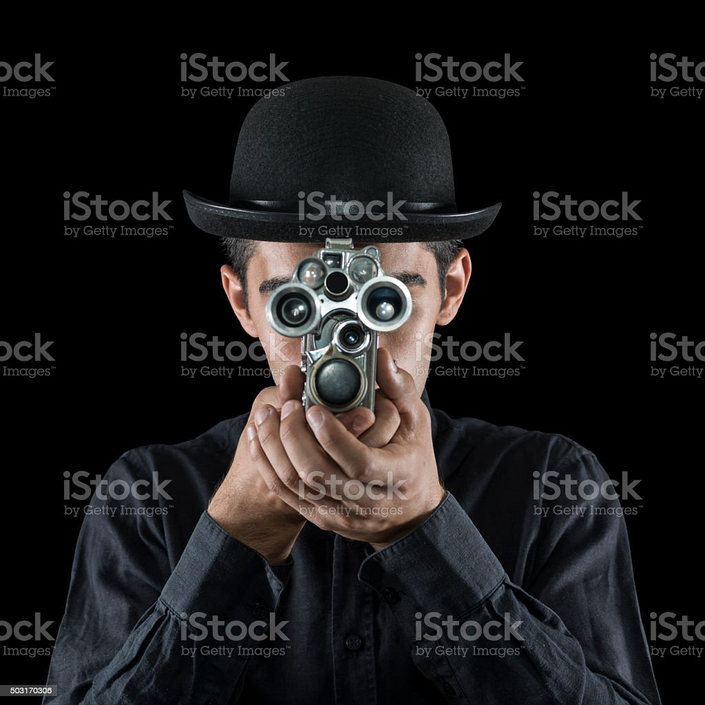 Young Man In Old Fashioned Style Filming Via Antique Camera stock photo