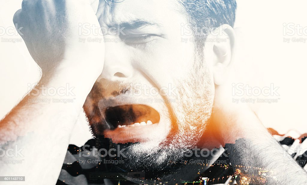 Young man in pain, double exposure image stock photo