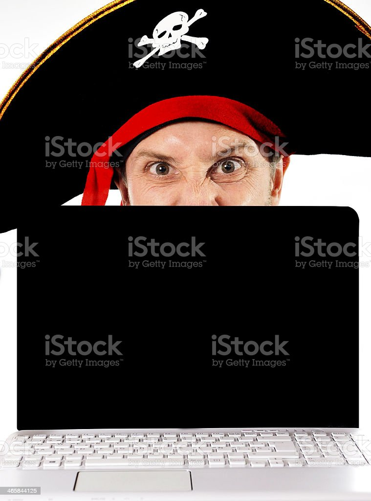 Young man in pirate costume and Computer stock photo