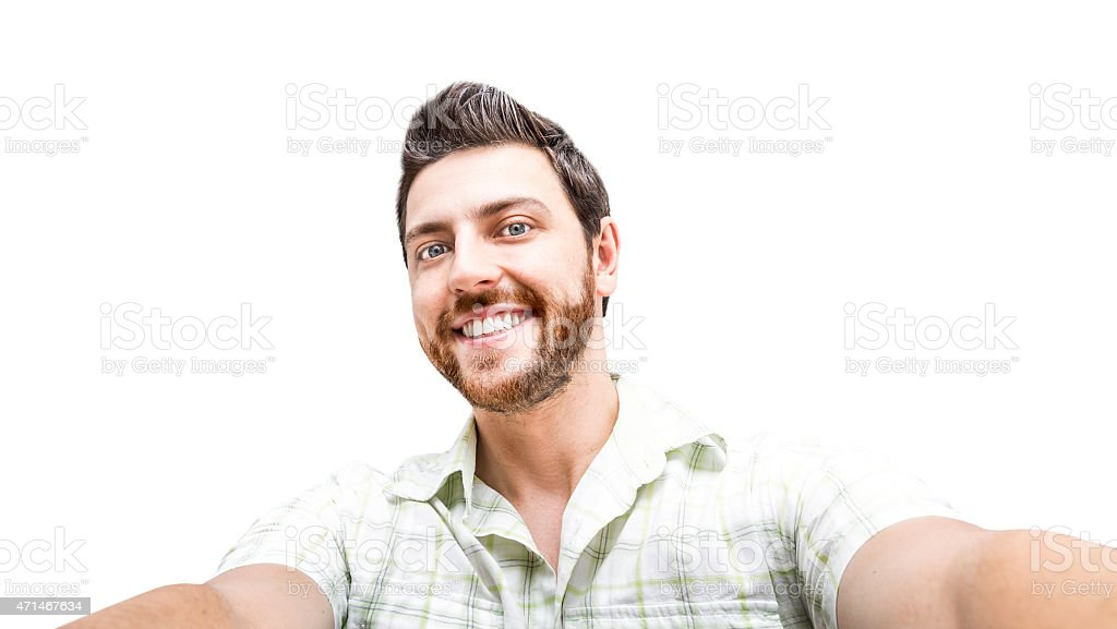 Young man in plaid shirt taking a selfie on white background stock photo