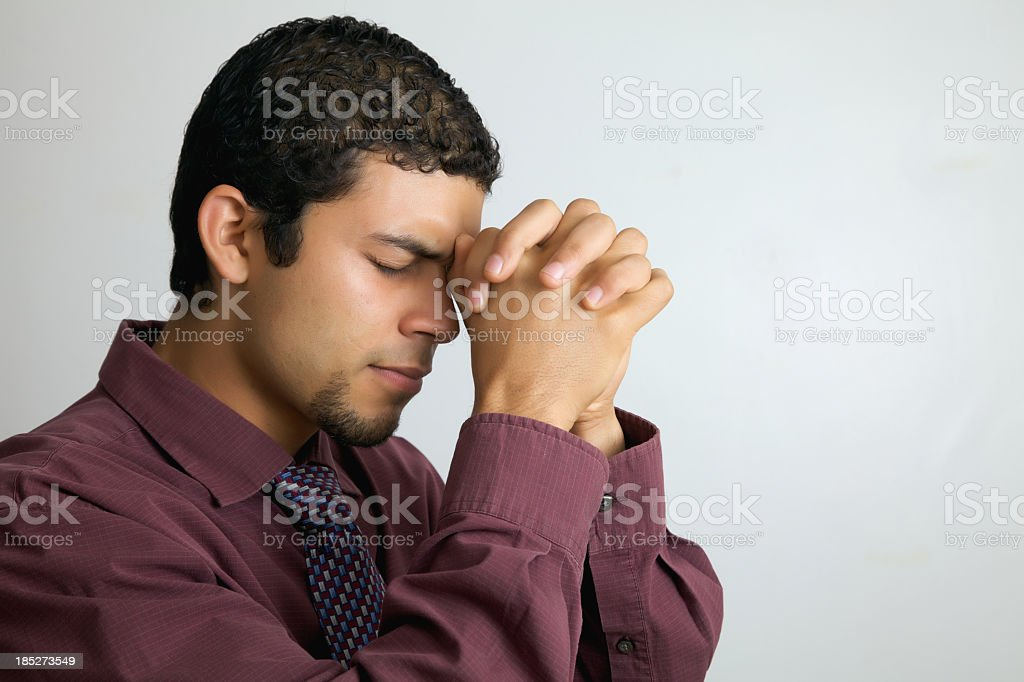 young man in pray royalty-free stock photo