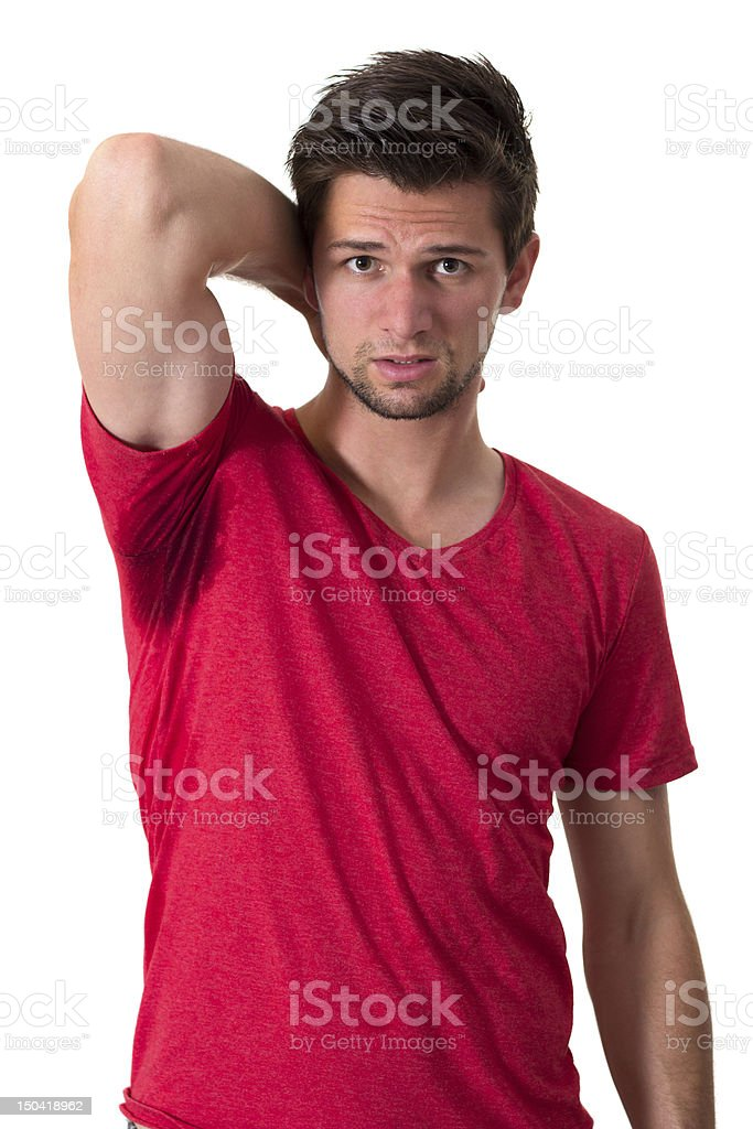 Young man in red t-shirt with large sweat stain in armpit stock photo