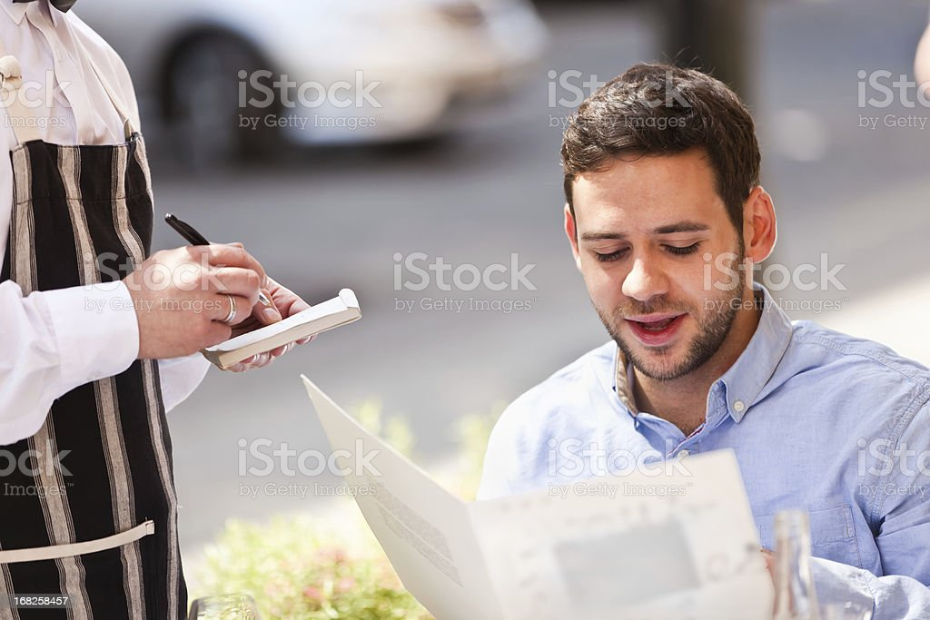 Young Man in Restarant Cafe royalty-free stock photo
