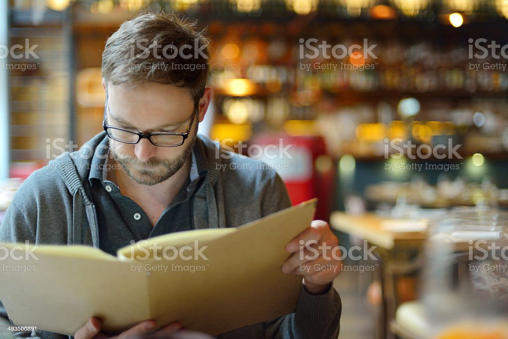 Young man in restaurant stock photo