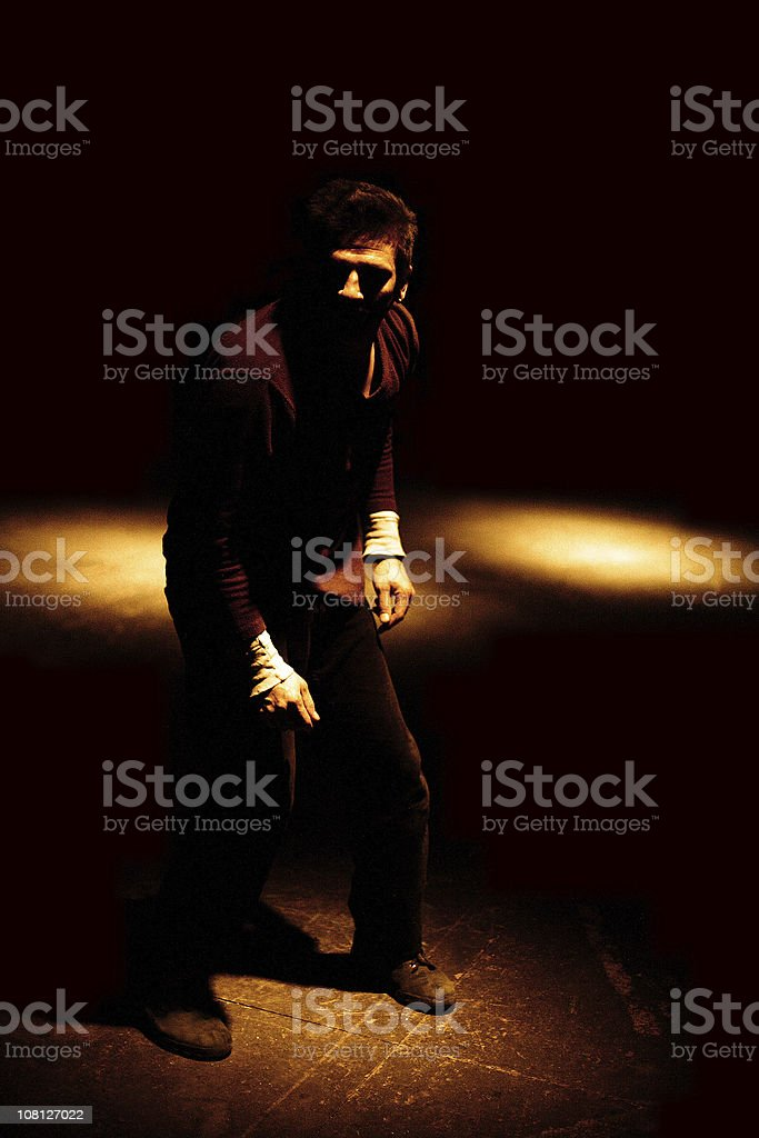 Young Man in Shadows stock photo